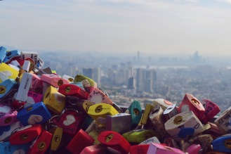 Once we got to the top of the tower, there was a huge wall of locks--actually--not even a wall, it was like a full room. Couples put their names on them and lock it on this lovegate as a symbol of longevity