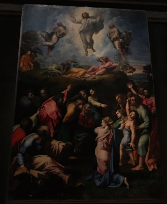Transfiguration--by Raffaello Sanzio. This famous painting is made up of two parts: the upper half which depicts Christ transfigured on Mount Tabor between Elijah and Moses, and the bottom half, where the apostles are attempting to cure a boy possessed by demons.